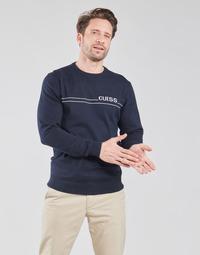 Oblečenie Muži Svetre Guess LS CN LOGO 12 GG Námornícka modrá