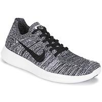 Topánky Ženy Bežecká a trailová obuv Nike FREE RUN FLYKNIT W Biela / čierna