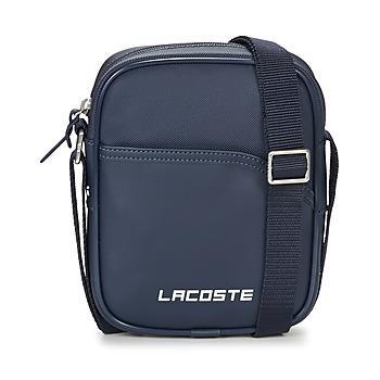 Tašky Muži Vrecúška a malé kabelky Lacoste ULTIMUM Námornícka modrá